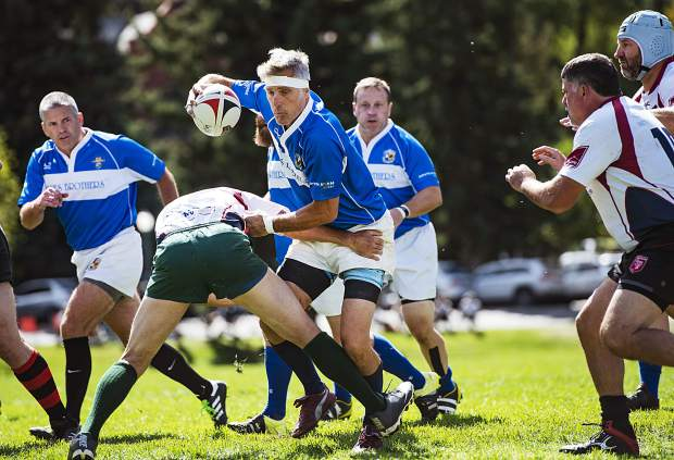 KC Blues Brothers player Bret Hann carries the ball during the match against Boulder Rugby at Wagner Park in Aspen on Friday, September 20, 2019. Hann coaches Arapahoe High School boys and girls rugby with teammate Darryl Lane. (Kelsey Brunner/The Aspen Times)