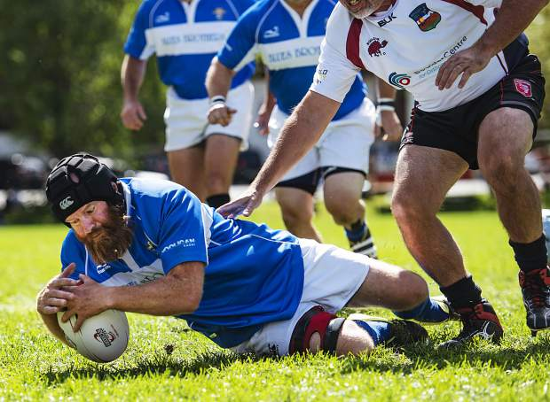 KC Blues Brothers player Darryl Lane keeps hold of the ball in the match against Boulder Rugby at Wagner Park in Aspen on Friday, September 20, 2019.  Hann coaches Arapahoe High School boys and girls rugby with teammate Bret Hann. (Kelsey Brunner/The Aspen Times)