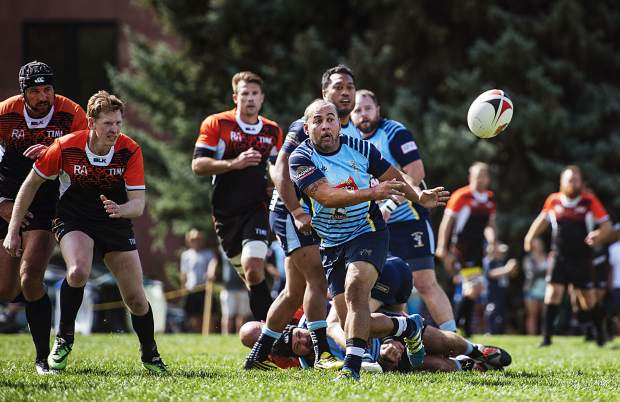 Mose Timoteo passes the ball to another teammate during the match against the Time at Wagner Park in Aspen on Friday, September 20, 2019. Timoteo is a former U.S. national team scrum half. (Kelsey Brunner/The Aspen Times)