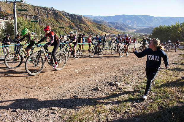 A teen cheers alongside junior varisty competitiors during the Colorado High School Cycling League's Snowmassive Chase on Sunday, Sept. 22.