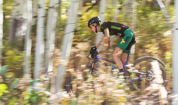 Riley Amos of Animas rides through the trees during the Snowmassive Chase boy's varsity race on Sunday, Sept. 22. Amos won with a time of 1:23:39:06.