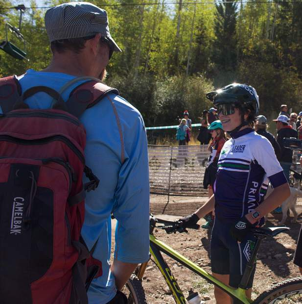 Finn Johnson of Aspen talks with Roaring Fork Cycling coach Tyler Durham after winning the freshman boy's race during the Snowmassive Chase on Sunday, Sept. 22.
