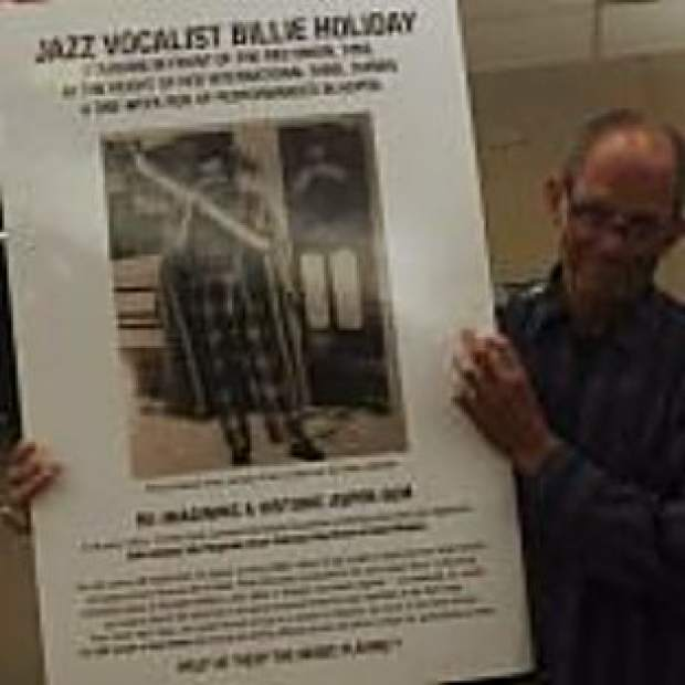 Jim Horowitz, president and CEO of Jazz Aspen Snowmass, holds up a poster showing an image of BIllie Holiday outside of the Red Onion in the 1950s. Many jazz greats came to Aspen and performed there during that era.