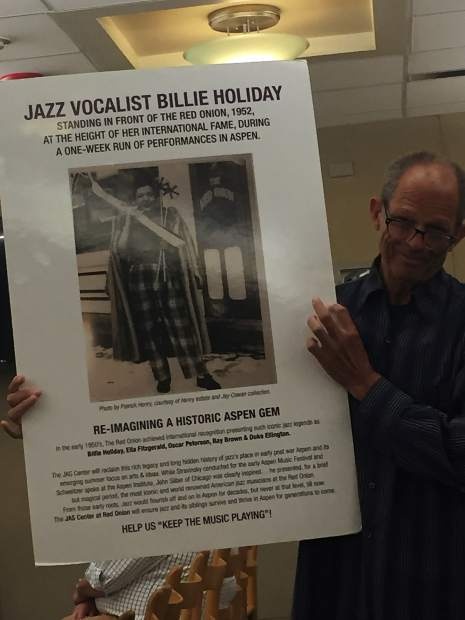 Jim Horowitz, president and CEO of Jazz Aspen Snowmass, holds up a photo of Billie Holiday in the 1950s in front of the Red Onion. Horowitz and developer Mark Hunt have approvals to redevelop the Red Onion building and adjacent properties into a performance center and a permanent home for the nonprofit.