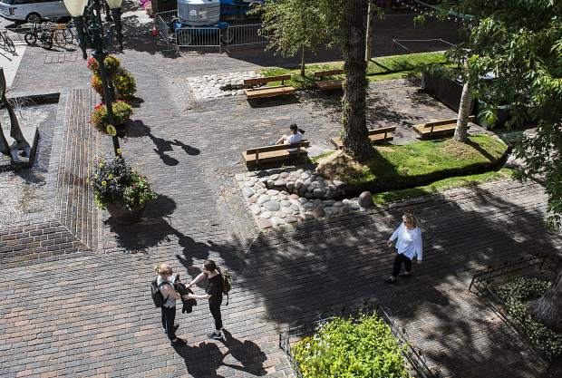 People mill around the walking mall on Tuesday, September 10, 2019. (Kelsey Brunner/The Aspen Times)