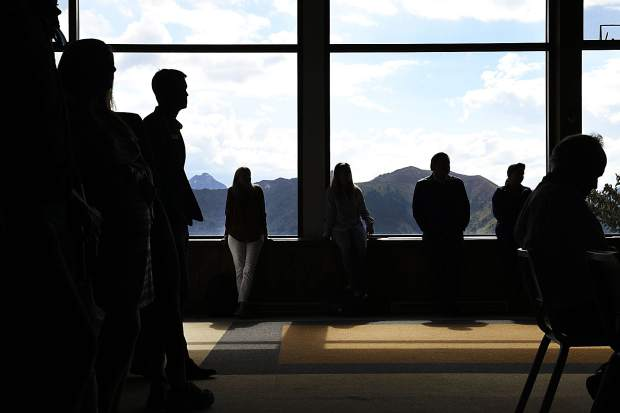 Attendees of the annual Skico Blend listen Wednesday to the speakers at the top of Aspen Mountain in the Sundeck Restaurant.