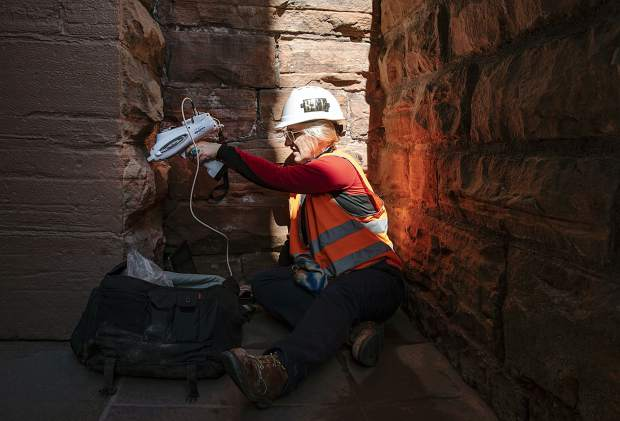 Architectural conservator Natalie Feinberg Lopez uses a XRF Spectrometer on the stonework of the Wheeler Opera House on Tuesday, September 17, 2019. The spectrometer performs an elemental analysis on the stone. Feinberg Lopez is testing areas that she cleaned with seven different cleaners three months ago to see which was most effective and the most gentle. (Kelsey Brunner/The Aspen Times)