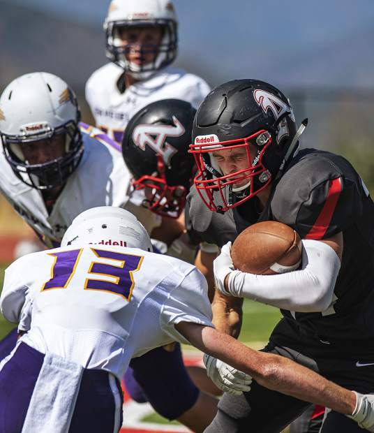 Aspen's Jonathon Woodrow runs the ball as Bayfield's Elyas Coleman attempts to tackle him during the varsity game in Aspen on Saturday, September 7, 2019. (Kelsey Brunner/The Aspen Times)