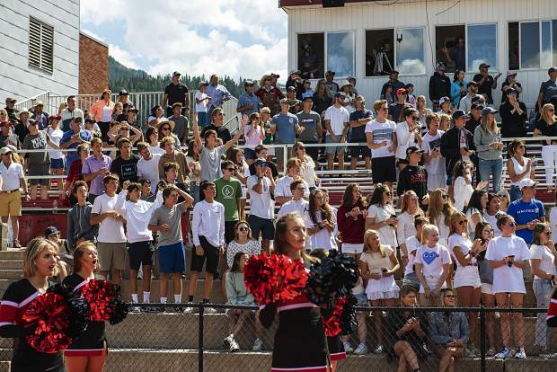 Cheerleaders and Aspen High School football fans watch a play from the stands during the varsity game against Bayfield High School on Saturday, September 7, 2019. (Kelsey Brunner/The Aspen Times)