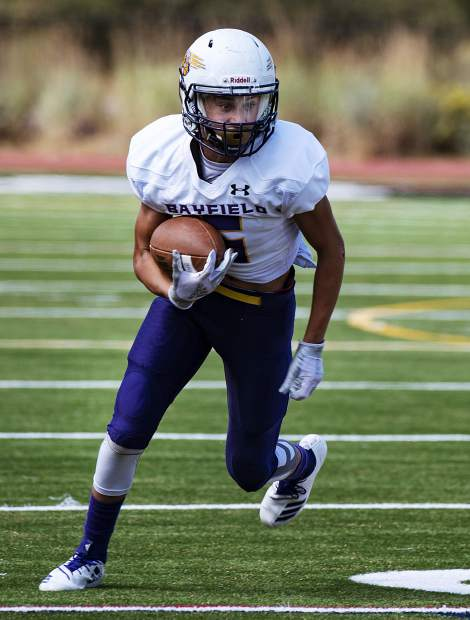 Bayfield High School's James Mars runs the ball during the game at Aspen High School on Saturday, September 7, 2019. (Kelsey Brunner/The Aspen Times)