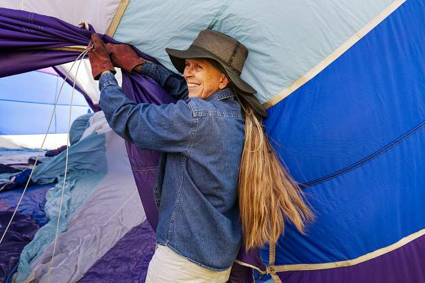 Marijo Ahnger holds the lip of the balloon while it begins to fill with air during the 44th Annual Snowmass Balloon Festival in Snowmass on Friday, September 6, 2019. Ahnger volunteered her time to help on Stephen Blucher's hot air balloon. Ahnger currently lives in an RV and is traveling around. She plans to be in Colorado for about six weeks.