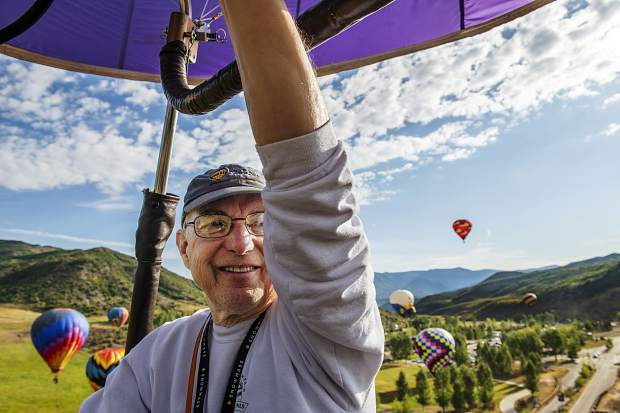 Morning Glory Too pilot Stephen Blucher looks over his shoulder as he adds more heat to the balloon during the first day of the 44th Annual Snowmass Balloon Festival in Snowmass on Friday, September 6, 2019.