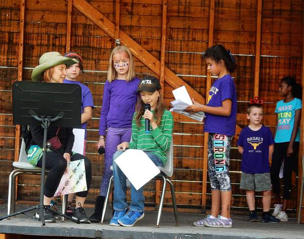 Basalt's next generation shows promise for battling climate change. Basalt 5th grader Oliver Fox-Rubin, sitting in center, speaks at a rally against climate change that he organized on Friday.