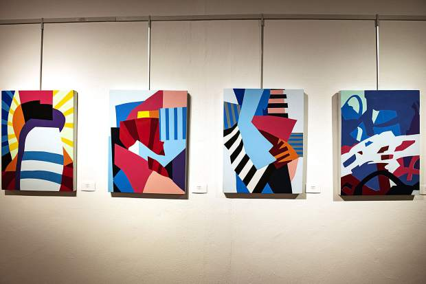 Enamel pieces by Chris Erickson hang in the Odyssey Collective Show in the Red Brick Center for the Arts on Wednesday.