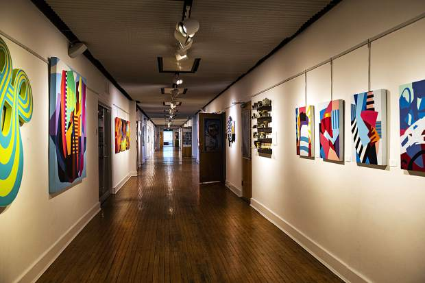 Work by artists Andrew Roberts-Gray, John Cohorst, and Chris Erickson hang down the main hallway of the Red Brick Center for the Arts on Wednesday.
