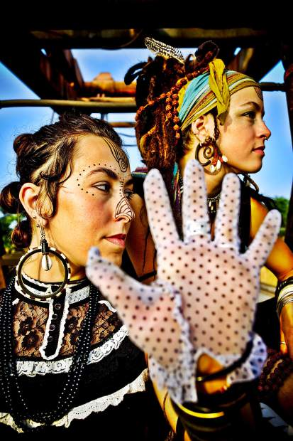 Sisters Leah and Chloe Smith lead the ecclectic roots music outfit Rising Appalachia. The band will headline Belly Up Aspen on Friday.