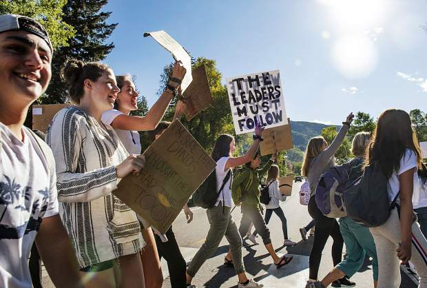 Students march across Main St. to Paepcke Park to listen to speeches during the Global Climate Strike event in Aspen on Friday, September 20, 2019. (Kelsey Brunner/The Aspen Times)