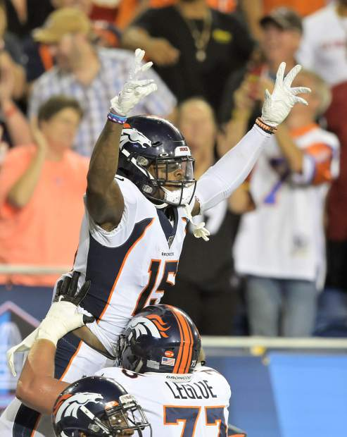 Denver Broncos wide receiver Juwann Winfree celebrates after catching a touchdown pass in an Aug. 1 preseason game in Canton, Ohio.
