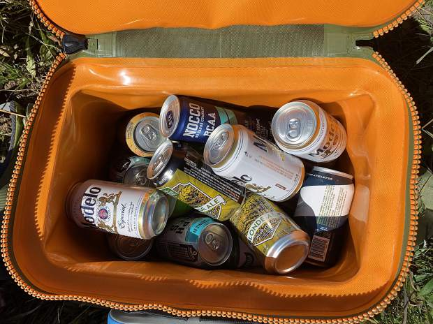 A cooler of cold beer is a welcome sight after a long hike.