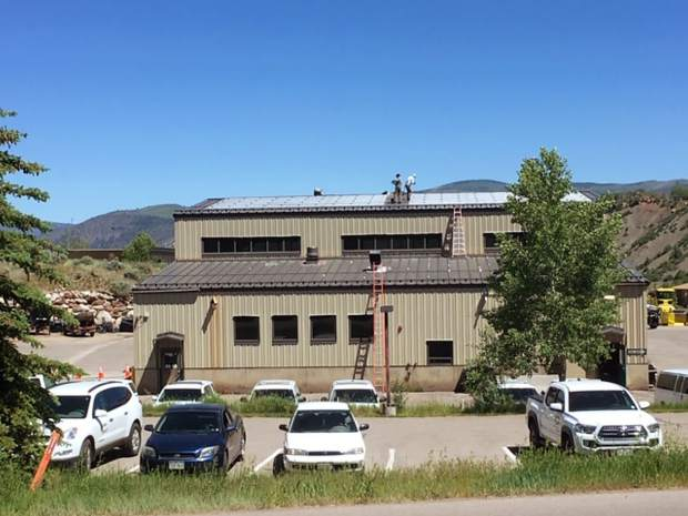 A crew installs solar panels on Pitkin County public works facility in this undated photo. The county tracks its greenhouse gas emissions, as do Aspen, Snowmass Village and Basalt.