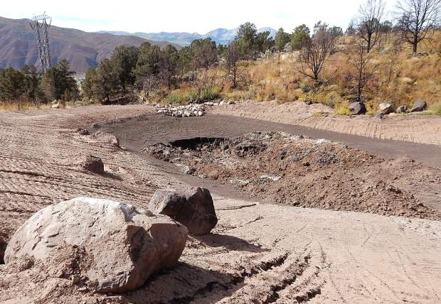Eagle County government is in the process of clearing mud and debris from a catch basin built this year above the Basberg Townhouses in Basalt. The basin prevented tons of mud from flowing into town in an Aug. 4 flash flood.