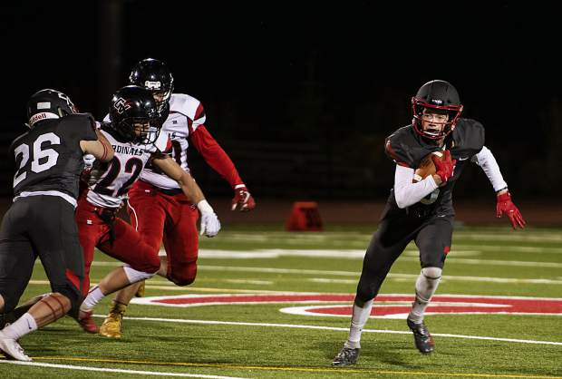 Aspen High School's Jack Seamans runs the ball during the homecoming game against Grand Valley High School in Aspen on Friday, Sept. 27, 2019. (Kelsey Brunner/The Aspen Times)
