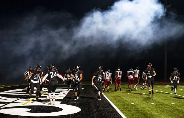 Smoke from the cannon billows over the field as the Aspen High School Skiers celebrate their first touchdown during the homecoming game against Grand Valley High School in Aspen on Friday, Sept. 27, 2019. (Kelsey Brunner/The Aspen Times)