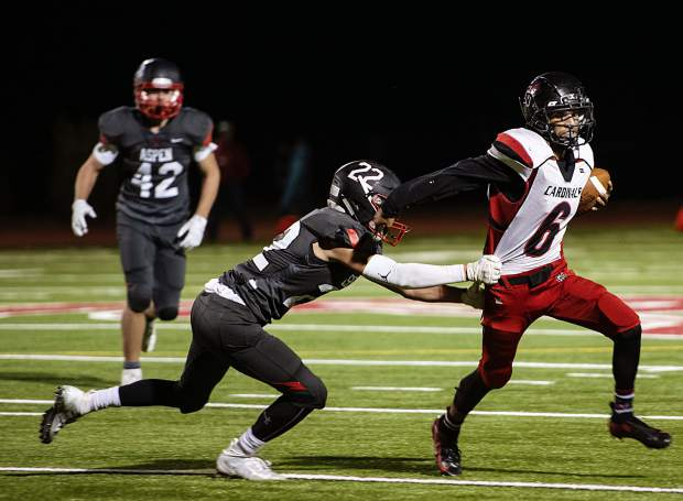Aspen High School's Kip Royer (22), left, attempts to tackle Grand Valley's Hector Delacruz (6) during the homecoming game in Aspen on Friday, Sept. 27, 2019. (Kelsey Brunner/The Aspen Times)