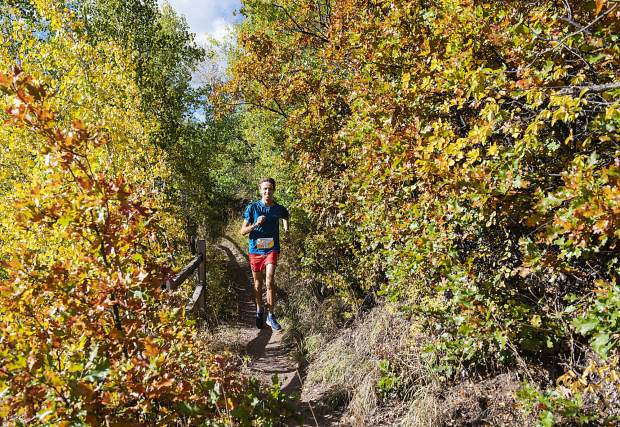 Bridger Tomlin, who finished 3rd in the overall men's class, competes in the Golden Leaf Half Marathon on Saturday, September 28, 2019. (Kelsey Brunner/The Aspen Times)