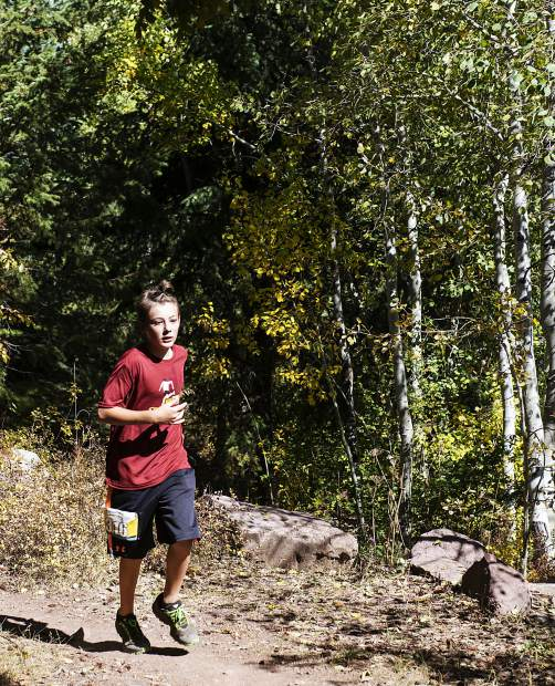 Tanner Powell, 13, runs along Government Trail near mile 11 during the Golden Leaf Half Marathon on Saturday, September 28, 2019. In the Male 13 and under class, Powell finished 3rd. (Kelsey Brunner/The Aspen Times)