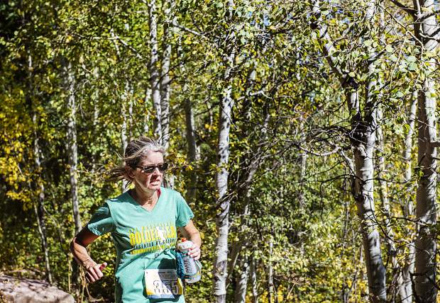 Justelle Grandsaert nears mile 11 during the Golden Leaf Half Marathon on Saturday, September 28, 2019. Grandsaert finished 69th in the overall women's class. (Kelsey Brunner/The Aspen Times)