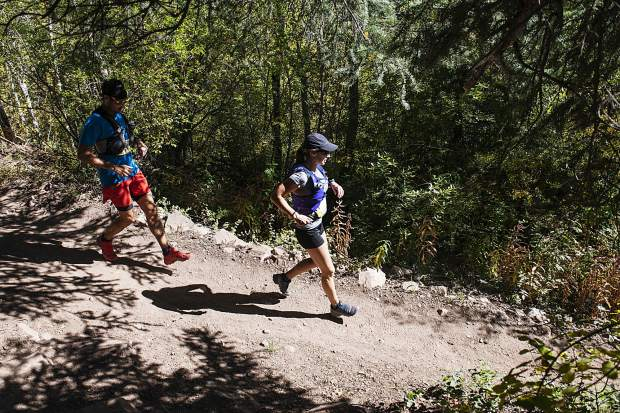 Runners descend the government trail during the Golden Leaf Half Marathon on Saturday, September 28, 2019. (Kelsey Brunner/The Aspen Times)