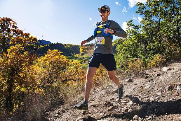 Ben Schreiber minds his step on the descent after the mile 11 marker near the Tiehack ski area on Saturday, September 28, 2019. Schreiber finished 72 in the overall men's class. (Kelsey Brunner/The Aspen Times)