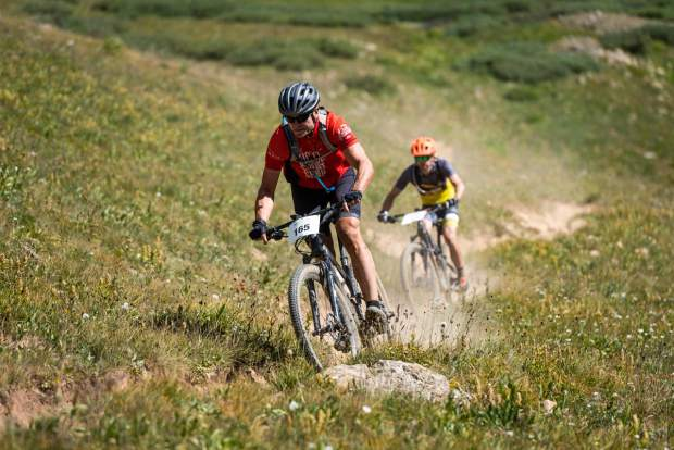 Noel Reuter, left, of Texas, takes part in the Grand Traverse mountain bike race on Sunday, Sept. 1, 2019, which goes from Aspen to the finish in Crested Butte. (Photo by Xavier Fane/courtesy)