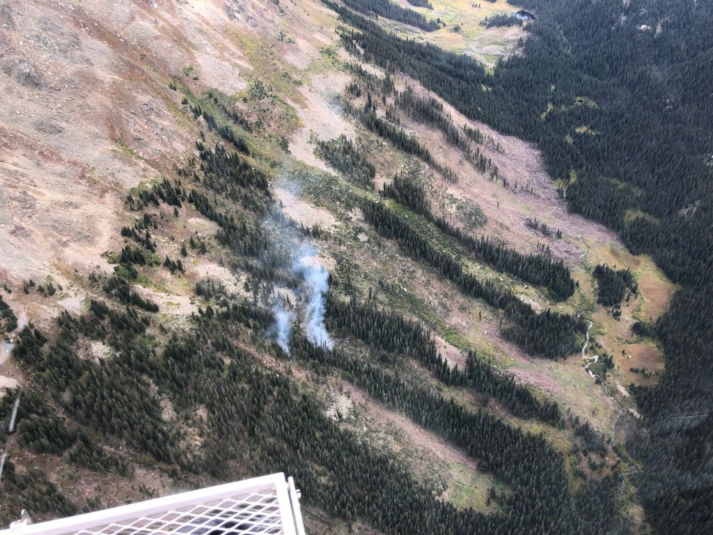 A flyover of the Granite Lakes fire last week shows it is burning in scattered timber at a high elevation. The fire was kicked up by gusty winds on Saturday and smoke became visible.