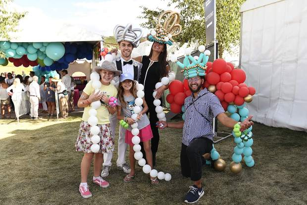 Scarlett, 11, and Leno, 8, pose with their day Shelly Hawkins, of Aspen, and members of Molly's balloons from Denver at the JAS Labor Day Experience in Snowmass Village on Saturday, Aug. 31.