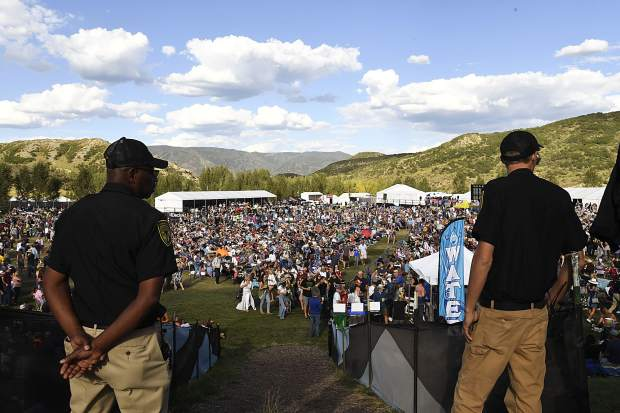 Security guards watch over the crowd at the JAS Labor Day Experience in Snowmass VIllage on Saturday, Aug. 31.