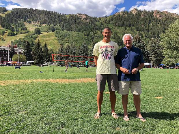 Claudio Borgiotti, left, stands next to Leon Fell near the MotherLode Volleyball Classic grass courts in Wagner Park. Fell, who has organized the annual Aspen tournament for 37 years, is transitioning out of his leadership role after this year. Borgiotti and the MotherLode Fresh Tracks group will head the event moving forward.