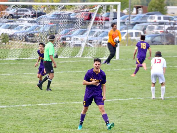 Basalt High School's Aaron Lopez, front, celebrates after BHS goalie Mateo Salazar made a critical save on a penalty kick in a 2-1 win the Aspen soccer team on Thursday, in Basalt.