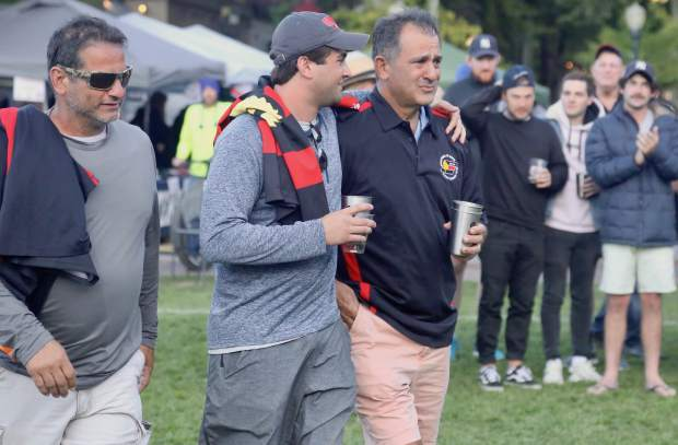 Led by brother Tom Hatem, at right, members of Jerry Hatem's family were presented with the championship trophy won by the Dark 'n Stormy Misfits in the 2019 Ruggerfest final on Sunday, Sept. 22, 2019, at Wagner Park in Aspen. Jerry Hatem, the former Aspen Rugby Club president, died in a June snowmobiling accident on Aspen Mountain and some of his family, mostly from Ohio, came to Aspen for the weekend to take part in a game Jerry loved. (Photo by Austin Colbert/The Aspen Times)