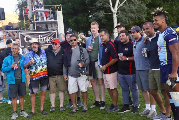 Members of Jerry Hatem's family pose with players and other members of the rugby community after the 2019 Ruggerfest final on Sunday, Sept. 22, 2019, at Wagner Park in Aspen. Jerry Hatem, the former Aspen Rugby Club president, died in a June snowmobiling accident on Aspen Mountain and some of his family, mostly from Ohio, came to Aspen for the weekend to take part in a game Jerry loved. (Photo by Austin Colbert/The Aspen Times)