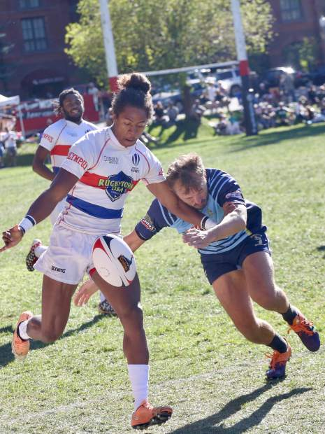 The Dark 'n Stormy Misfits, in blue, play NA Rugby in the 2019 Ruggerfest final on Sunday, Sept. 22, 2019, at Wagner Park in Aspen. (Photo by Austin Colbert/The Aspen Times)