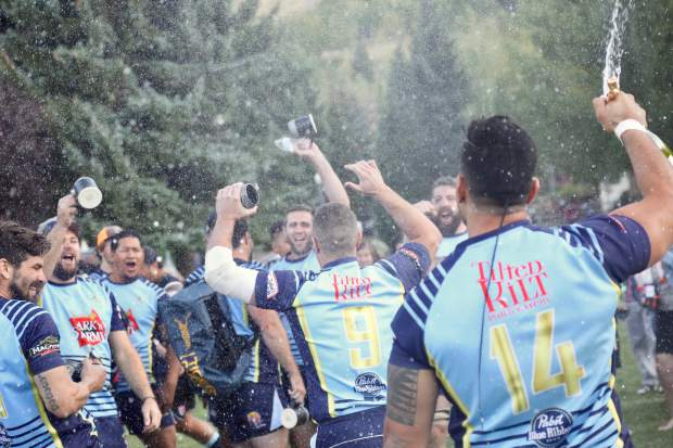The Dark 'n Stormy Misfits celebrate after beating NA Rugby in the 2019 Ruggerfest final on Sunday, Sept. 22, 2019, at Wagner Park in Aspen. (Photo by Austin Colbert/The Aspen Times)