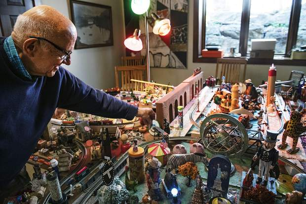 Frank Herzog readjusts a clock on his elaborate display of the Roaring Fork Valley in the home he and his wife rent for the summer in Aspen on Saturday, September 21, 2019.