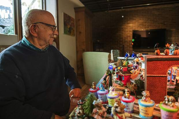 Frank Herzog watches his model trains move around his elaborate display in the home he and his wife rent for the summer in Aspen on Saturday, September 21, 2019.