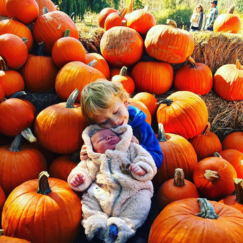 Brotherly love for Cooper and Caden Van Ohlen, snuggling in Rock Bottom Ranch's pumpkin patch.