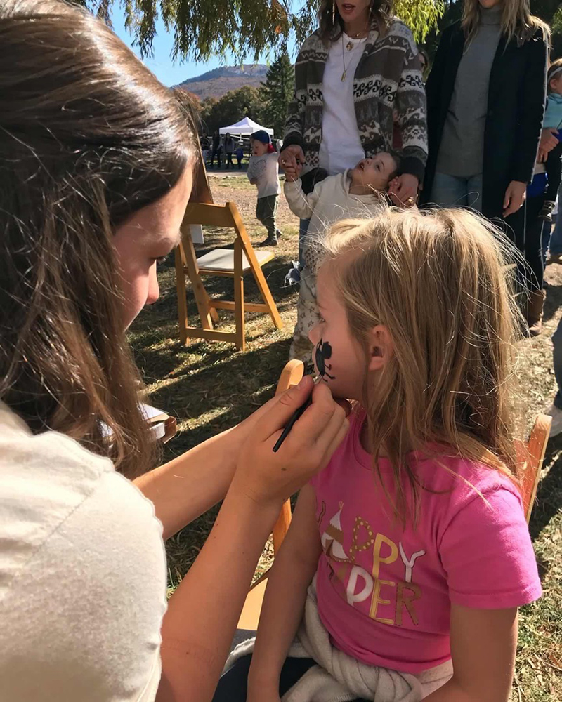 Patiently awaiting face painting at Harvest Fest 2019.