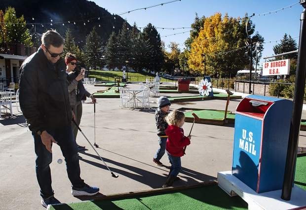 The Tetrault family start a game of mini golf outside of CP Burger on Friday, October 11, 2019. The family lives in Colorado Springs. (Kelsey Brunner/The Aspen Times)