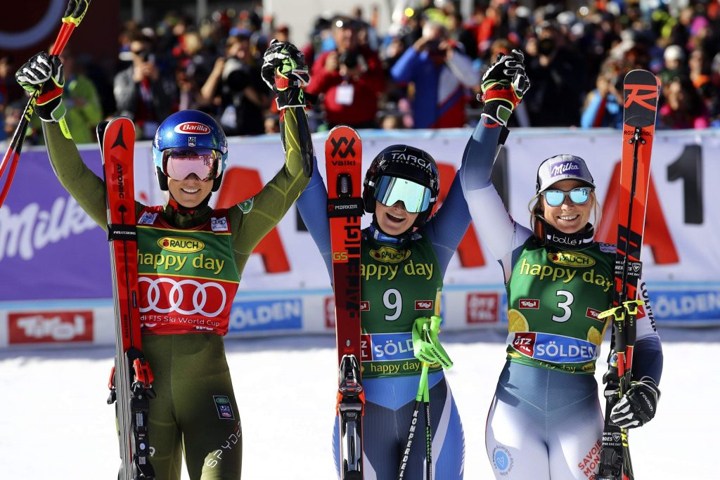 New Zealand's Alice Robinson, center, winner of an alpine ski, women's World Cup giant slalom, poses with second placed United States' Mikaela Shiffrin, left, and third placed France's Tessa Worley, in Soelden, Austria, Saturday, Oct. 26, 2019. (AP Photo/Marco Trovati)