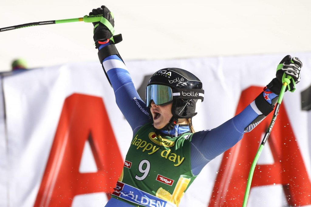 New Zealand's Alice Robinson celebrates winning an alpine ski, women's World Cup giant slalom in Soelden, Austria, Saturday, Oct. 26, 2019. (AP Photo/Alessandro Trovati)